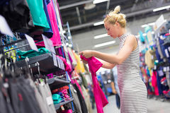 Woman shopping sportswear in sports store. Royalty Free Stock Image