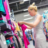 Woman shopping sportswear in sports store. Royalty Free Stock Photography