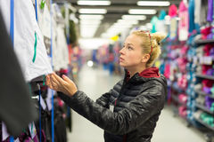 Woman shopping sportswear in sports store. Stock Images