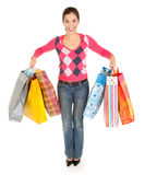 Woman on a Shopping Spree. A young woman on a shopping spree royalty free stock images