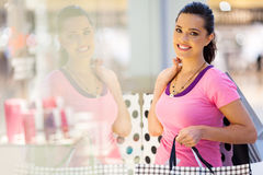 Woman shopping spree. Happy young woman shopping spree stock image