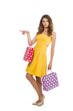 Woman after shopping spree. On white Stock Images