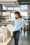 Woman shopping in store. Stock Photography