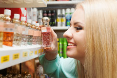 Woman shopping in  store. Portrait of lovely young woman shopping in beauty store Royalty Free Stock Photo