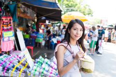 Woman shopping at street and enjoy coconut juicy Stock Photography