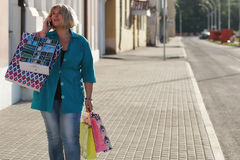 Woman shopping in summer Royalty Free Stock Image
