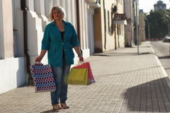 Woman shopping in summer. Portrait of a nice girl on a sunny summer day in the city streets Royalty Free Stock Image
