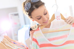 Woman shopping on summer sales. Beautiful woman in clothing store during summer sales Royalty Free Stock Images