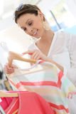 Woman shopping during summer sales of clothing Stock Image