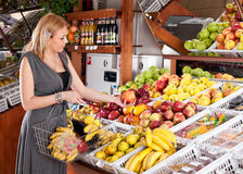 Woman shopping in supermarket Stock Photography