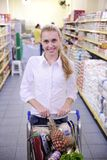 Woman shopping in the supermarket Stock Photos