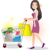 Woman  shopping in supermarket. Woman holding  shopping cart in supermarket Royalty Free Stock Photos