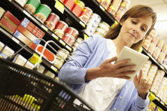 Woman shopping in supermarket Stock Image