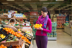 Woman Shopping At The Supermarket Stock Photos
