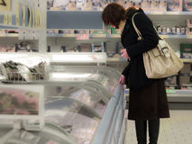 Woman shopping at the supermarket  customer is choosing food Stock Photo