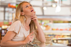Woman shopping at the supermarket stock images