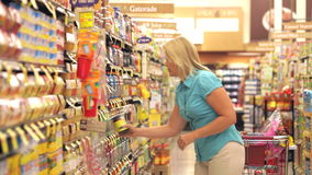 Woman Shopping In Supermarket stock video