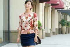 Woman shopping in Suzhou Village Shopping Area. Stock Photos