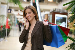 Woman Shopping and Talking Stock Photography