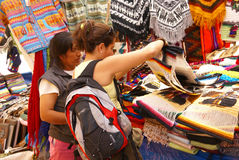 Woman shopping for textiles. CUSCO, PERU 24 AUGUST 2008 - Woman shopping for textiles in Pisac market, Cusco,Peru, South America Stock Photography