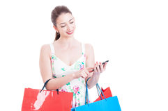 Woman at shopping texting or checking smartphone Royalty Free Stock Images