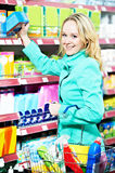 Woman shopping toiletries and household cleaning supplies Royalty Free Stock Image