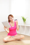Woman shopping with touch pad and credit card Stock Photo