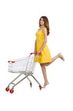 Woman with shopping trolley isolated Stock Image