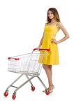 Woman with shopping trolley isolated Stock Images