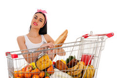 Woman with shopping trolley supermarket. Beautiful woman with shopping trolley supermarket Royalty Free Stock Image