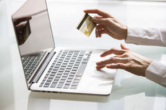 Woman shopping using laptop and credit card .indoor.close-up Royalty Free Stock Images