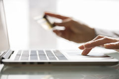 Woman shopping using laptop and credit card .indoor.close-up Royalty Free Stock Photo