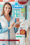 Woman shopping and using a tablet Stock Images