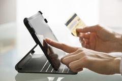 Woman shopping using tablet pc and credit card .indoor.close-up Stock Photos
