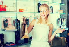 Woman shopping various bijouterie Royalty Free Stock Images