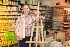 Woman shopping various supplies in art store Stock Photos