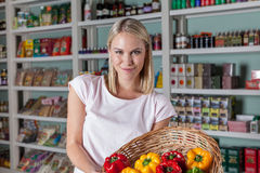 Woman shopping vegetables. Woman buying some vegetables and smiling Royalty Free Stock Image