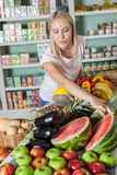 Woman shopping vegetables. Happy woman buying some vegetables Stock Photos