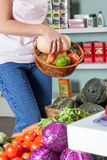 Woman shopping vegetables. Happy woman buying some vegetables Stock Photo