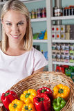Woman shopping vegetables. Pretty woman showing some vegetables Stock Photo