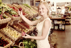 Woman shopping veggies Stock Photo