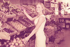 Woman shopping veggies Royalty Free Stock Photos