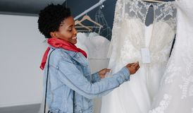Woman shopping for wedding outfit in bridal boutique Stock Photos