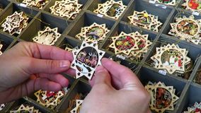 Shopping for Wooden Christmas Tree Ornaments at Christmas Market stock video footage