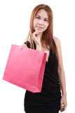 Woman in shopping. Young asian woman with red shopping bag on white background Stock Photography
