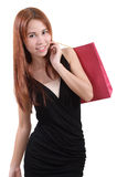 Woman in shopping. Young asian woman with red shopping bag on white background Stock Photo