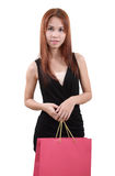 Woman in shopping. Young asian woman with red shopping bag on white background Royalty Free Stock Photo