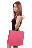 Woman in shopping. Young asian woman with red shopping bag on white background Stock Images