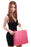Woman in shopping. Young asian woman with red shopping bag on white background Stock Photos