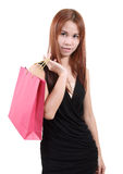 Woman in shopping. Young asian woman with red shopping bag on white background Royalty Free Stock Photos